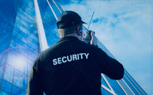 Security guard outside tower